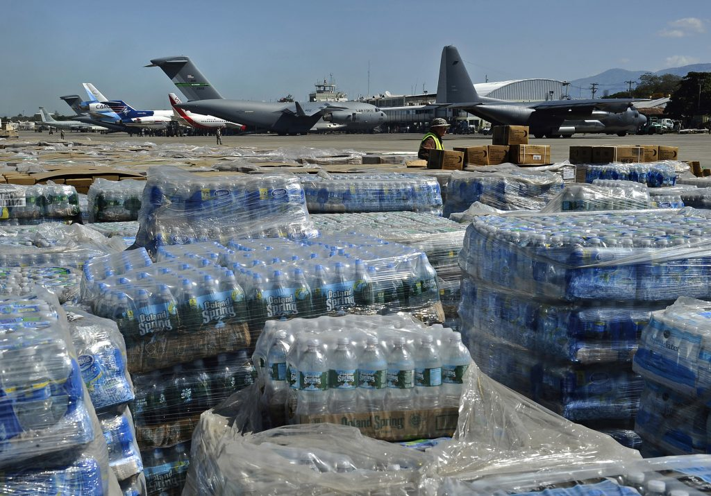 100128-N-5345W-098 PORT-AU-PRINCE, Haiti (Jan. 28, 2010) Pallets of humanitarian aid and bottled water are lined up in a staging area just off the tarmac of Aerodome de Jacmel, an airport in Port-au-Prince, while cargo planes from various nations sit at the airport's terminal facility. The multi-purpose amphibious assault ship USS Bataan (LHD 5) and the amphibious dock landing ships USS Fort McHenry (LSD 43), USS Gunston Hall (LSD 44) and USS Carter Hall (LSD 50) are participating in Operation Unified Response as the Bataan Amphibious Relief Mission by providing military support capabilities to civil authorities to help stabilize and improve the situation in Haiti in the aftermath of a 7.0 magnitude earthquake on Jan. 12, 2010. (U.S. Navy photo by Mass Communication Specialist 2nd Class Kristopher Wilson/Released)